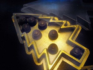 Gold plastic trays pralines